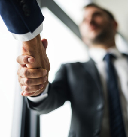 Business men shaking hands in a business or corporate transaction